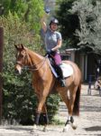 Actress Kaley Cuoco is all smiles on the back of her horse!